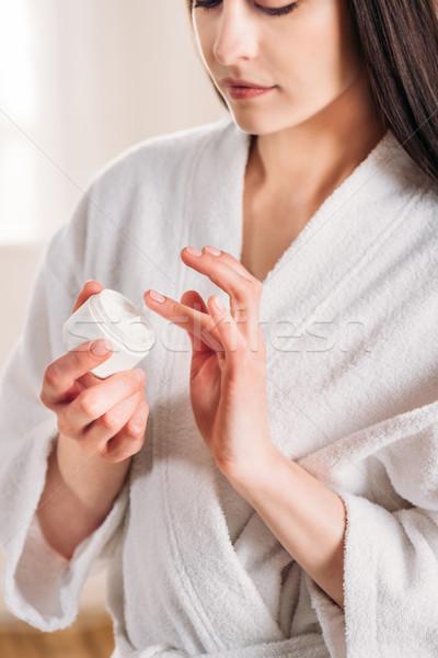 Stock photo: woman taking cream from jar