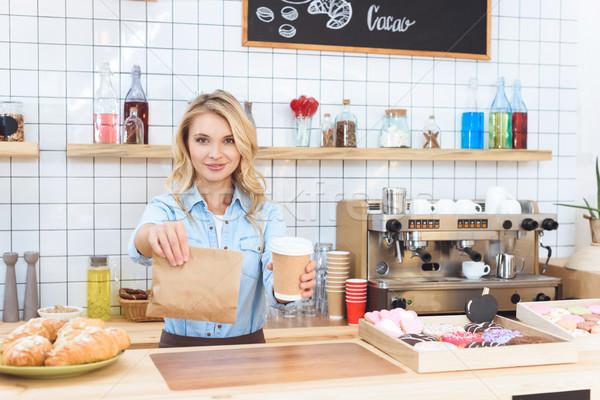 waitress holding coffee to go Stock photo © LightFieldStudios