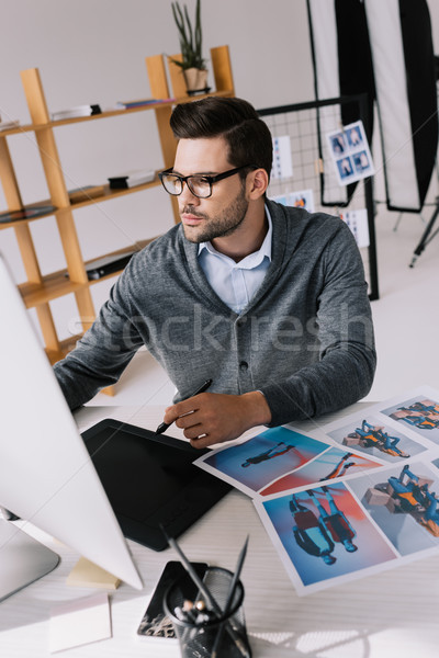 photographer with graphics tablet and photos Stock photo © LightFieldStudios