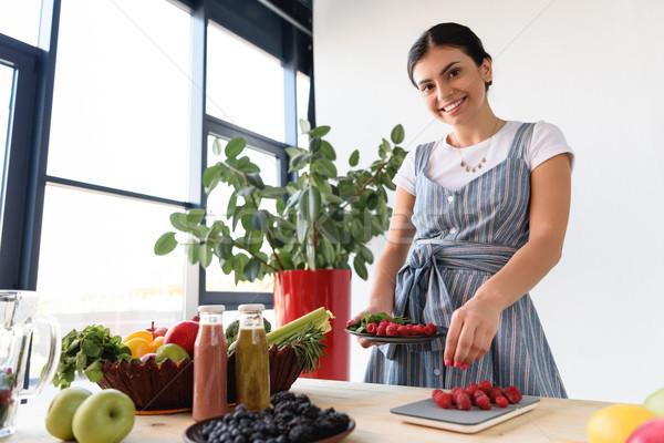 woman weighting raspberries Stock photo © LightFieldStudios
