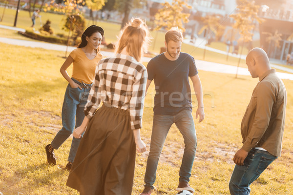 multicultural friends playing football Stock photo © LightFieldStudios
