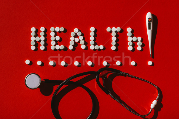 Stock photo: word health from pills and stethoscope