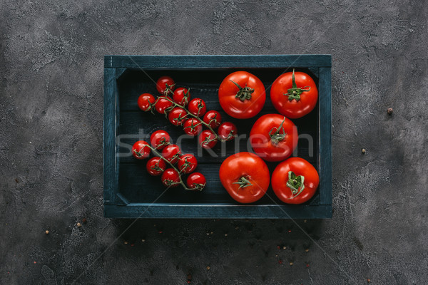 top view of various tomatoes in box on concrete surface Stock photo © LightFieldStudios