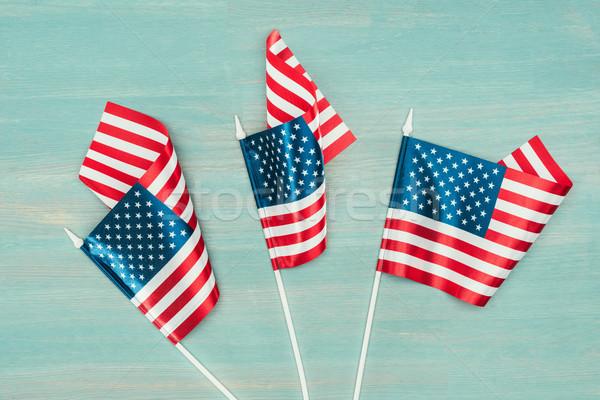 Felső kilátás amerikai zászlók kék fából készült Stock fotó © LightFieldStudios