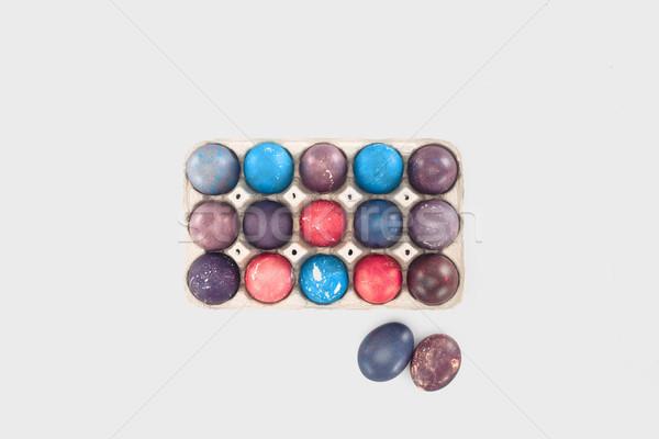 Felső kilátás tele tálca festett tojások Stock fotó © LightFieldStudios