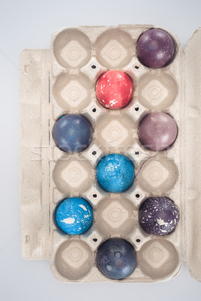 top view of painted easter eggs in tray, isolated on white Stock photo © LightFieldStudios