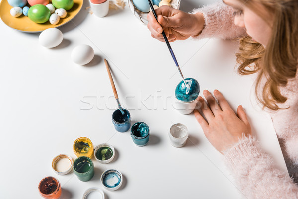 cropped shot of girl painting egg for Easter  Stock photo © LightFieldStudios