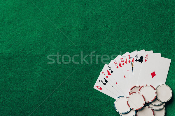 Gambling concept with cards and chips on casino table Stock photo © LightFieldStudios
