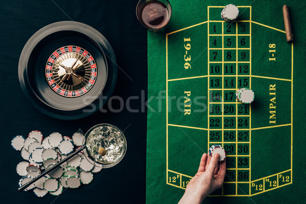 Woman placing a bet on table with roulette Stock photo © LightFieldStudios