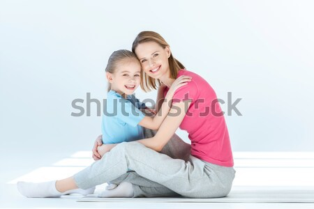 happy daughter and mother hugging each other on white Stock photo © LightFieldStudios