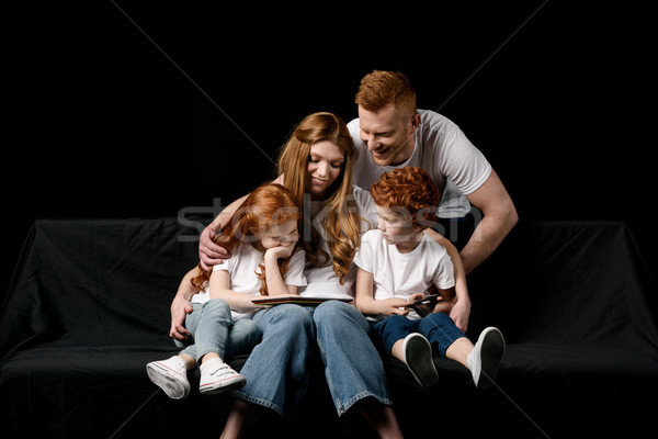 happy family using digital tablet isolated on black Stock photo © LightFieldStudios