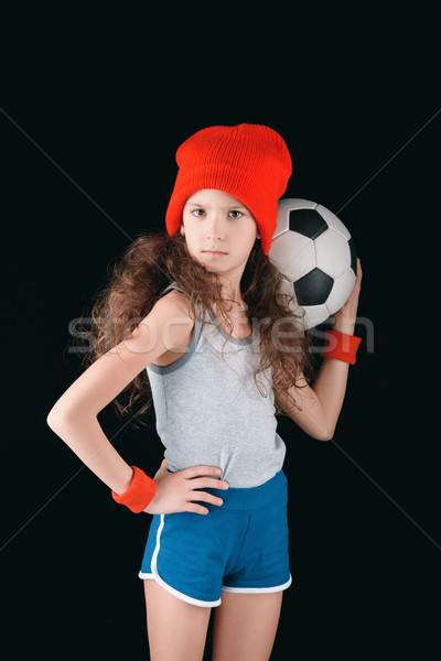 portrait of sportive girl with soccer ball isolated on black, active kids concept Stock photo © LightFieldStudios