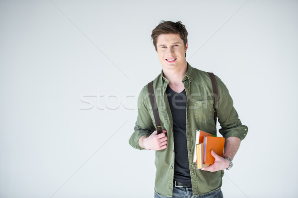young student holding copybooks and books on white wth copy space Stock photo © LightFieldStudios