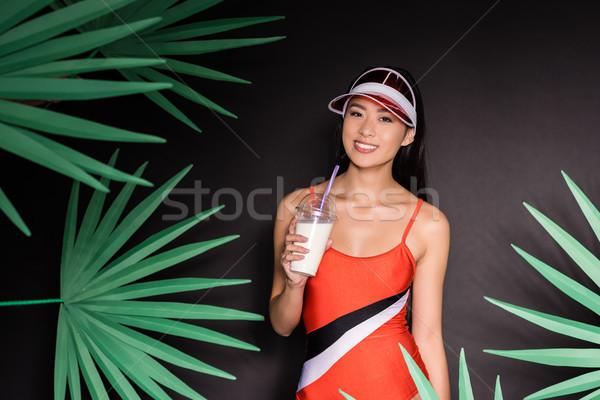 женщину купальник питьевой выстрел улыбаясь азиатских Сток-фото © LightFieldStudios