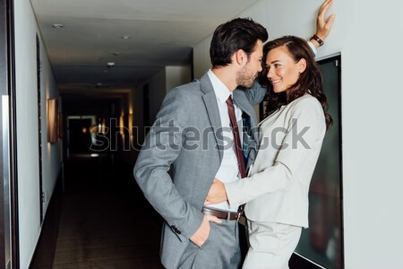 Woman pulling man by necktie Stock photo © LightFieldStudios