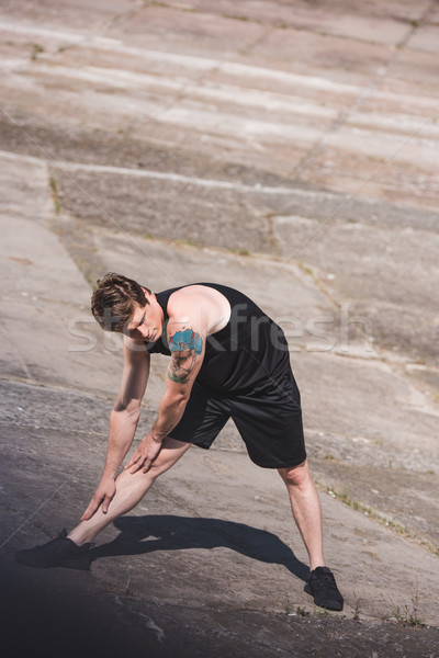 Stock photo: man stretching on slabs