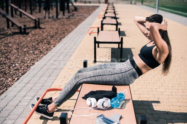 woman doing abs exercise Stock photo © LightFieldStudios