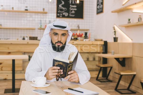 Muszlim férfi fiatal ül modern kávézó Stock fotó © LightFieldStudios