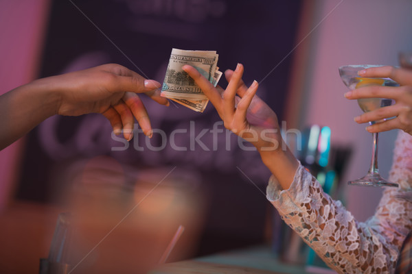 woman paying barman for cocktails Stock photo © LightFieldStudios
