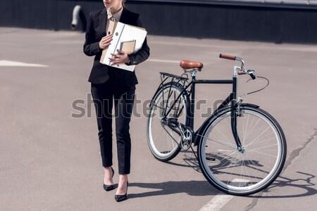 woman riding vintage bicycle Stock photo © LightFieldStudios