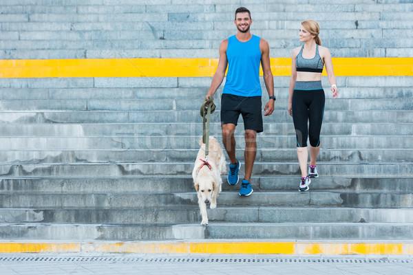 Sportok pár sétál kutya sportos város Stock fotó © LightFieldStudios