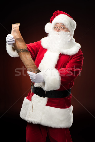 Santa Claus reading wishlist Stock photo © LightFieldStudios