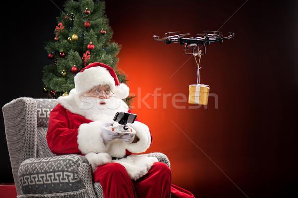 Santa Claus using drone Stock photo © LightFieldStudios