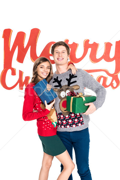 smiling couple with christmas presents Stock photo © LightFieldStudios