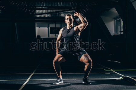 athletic man doing push ups Stock photo © LightFieldStudios
