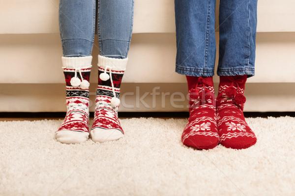 Couple tricoté chaussettes vue pieds Photo stock © LightFieldStudios