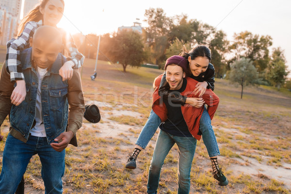 happy couples piggybacking together Stock photo © LightFieldStudios