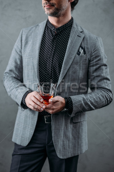businessman drinking whiskey Stock photo © LightFieldStudios