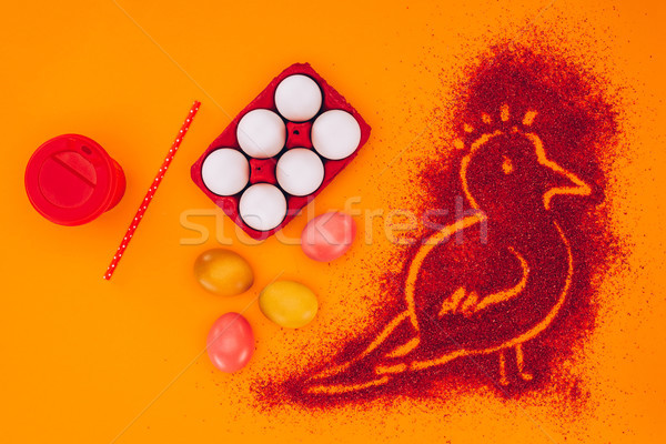 top view of bird made of red sand with chicken eggs isolated on orange, easter concept Stock photo © LightFieldStudios