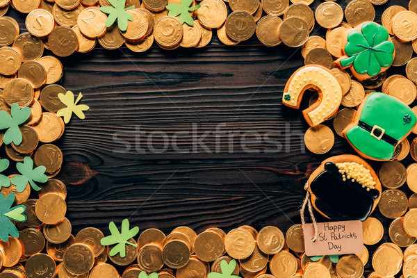 top view of golden coins and icing cookies on table, st patricks day concept Stock photo © LightFieldStudios