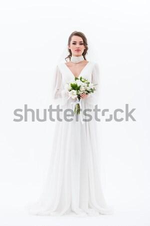 elegant bride in traditional dress holding wedding bouquet, isolated on white Stock photo © LightFieldStudios