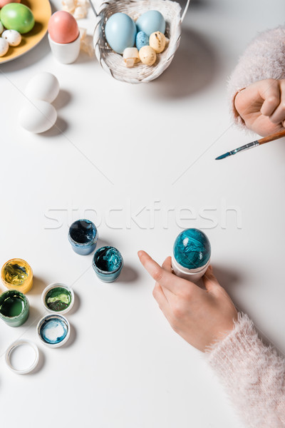 close-up partial view of child painting easter egg at table Stock photo © LightFieldStudios