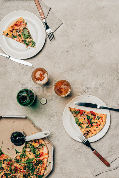 Top view of pizza and drink on light background Stock photo © LightFieldStudios
