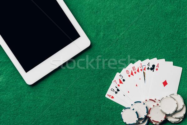 Online gioco d'azzardo carte da gioco chip digitale tablet Foto d'archivio © LightFieldStudios