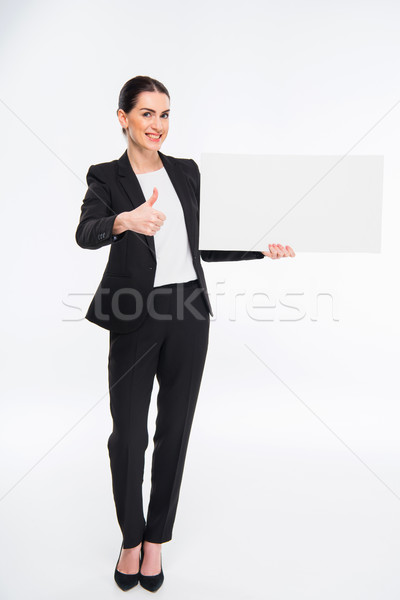 üzletasszony tart üres kártya mosolyog mutat hüvelykujj Stock fotó © LightFieldStudios