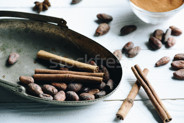 cacao beans and cinnamon sticks Stock photo © LightFieldStudios