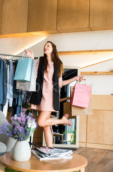 girl with shopping bags in boutique Stock photo © LightFieldStudios