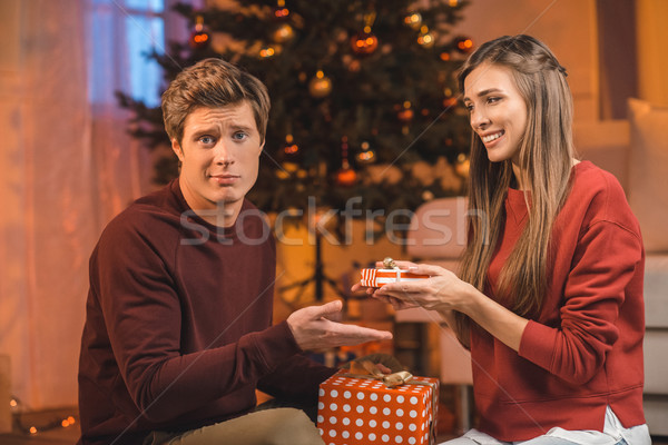 couple exchanging christmas gifts Stock photo © LightFieldStudios