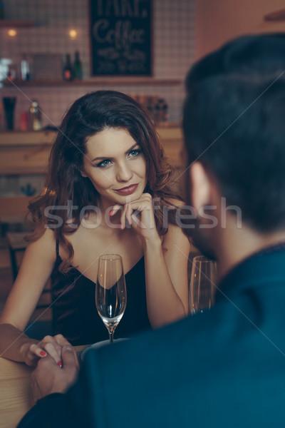 Femme regarder copain vue belle femme romantique Photo stock © LightFieldStudios