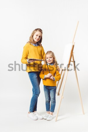 mother and daughter with party masks  Stock photo © LightFieldStudios