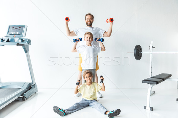 father and sons exercising with dumbbells Stock photo © LightFieldStudios