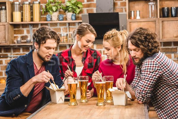 Friends eating noodles Stock photo © LightFieldStudios