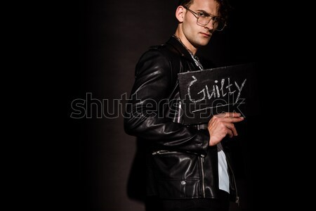 Sophisticated man adjusting jacket Stock photo © LightFieldStudios