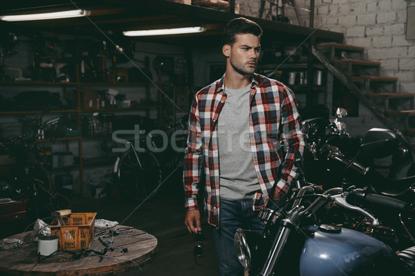 motorcyclist in repair shop Stock photo © LightFieldStudios