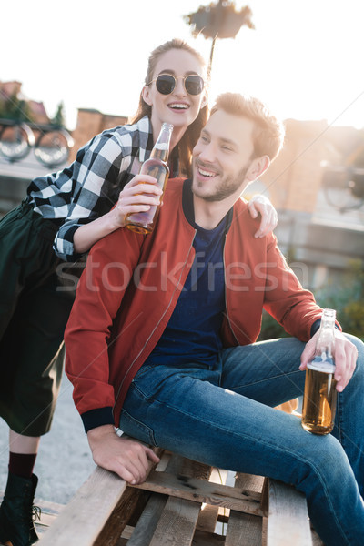 happy couple with drinks Stock photo © LightFieldStudios