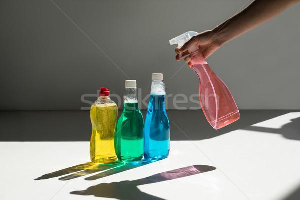 Сток-фото: человеческая · рука · очистки · выстрел · спрей · бутылку
